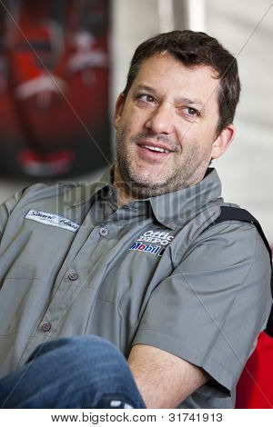 FONTANA, CA - MARCH 25:  Tony Stewart (14) takes time out to talk to guests of Office Depot during the Auto Club 400 at the Auto Club Speedway in Fontana, CA on March 25, 2012.