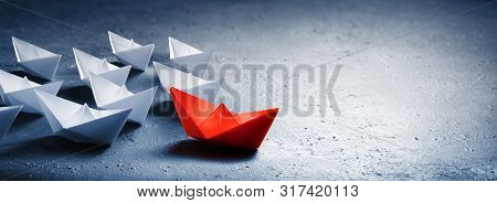 Red Leader Paper Boat Leading Group Of Paper Boates
