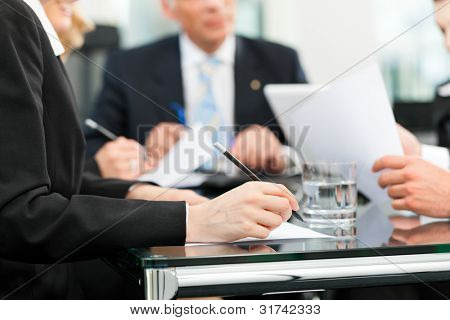 Business - meeting in an office, lawyers or attorneys discussing a document or contract agreement poster