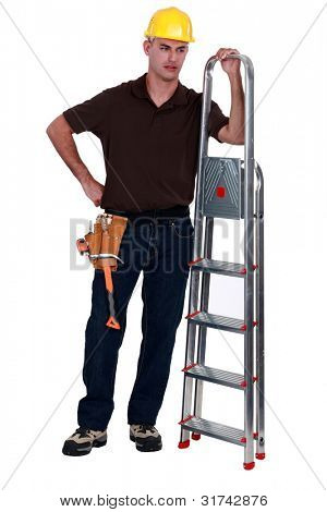 Haughty tradesman posing with a stepladder