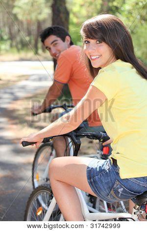Young couple enjoying bike ride together