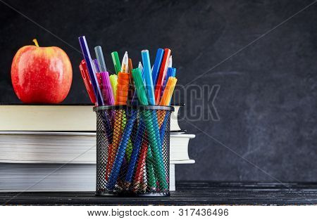 Back To School Background With Books And Apple Over Blackboard With Copy Space. Back To School Conce
