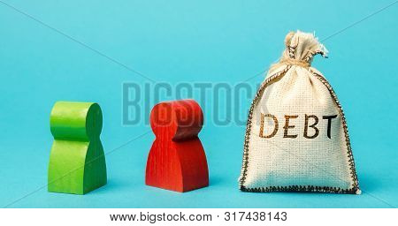 Two Businessmen Are Standing Near A Money Bag With The Word Debt. Lender And Borrower. Debt Details