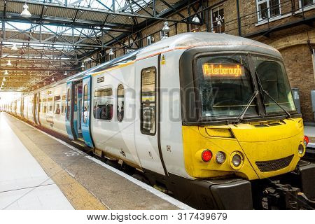 London, England-13 October,2018: London Train Tube Station With Local People And Group Tourist Walki