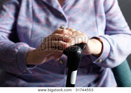 Close Up Of Senior Woman Holding Walking Stick