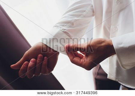 The Man Fastens The Cuffs Of The Shirt. Morning Of The Groom. Hands Of Wedding Groom Buttoning Up Hi