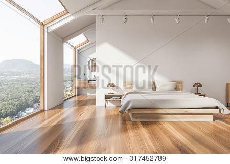 White Attic Bedroom Interior With Bathroom
