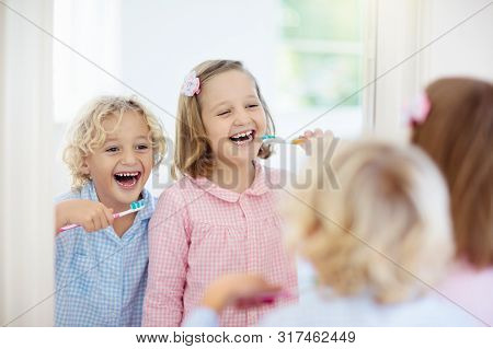 Child Brushing Teeth. Kids With Toothpaste, Brush.