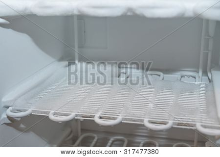 Iced Freezer - Close-up Of Refrigerated Louvres Of A Freezer With Ice Coating