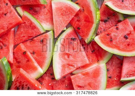 Summer ripe sliced watermelon, top view. Juicy slice of ripe watermelon. Concept summer watermelon. Summer ripe berry