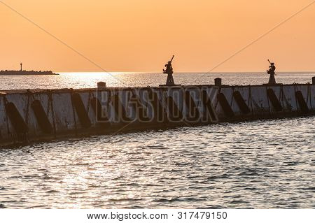 Sea sunset over baltic pier. Dreams of travel and freedom. Beautiful jetty seascape. Sundown sky and claim weather. poster