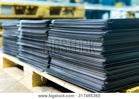 Steel Sheets Deposited In Stacks In Packs At The Warehouse Of Metal Products. Weathered Metals Sheet