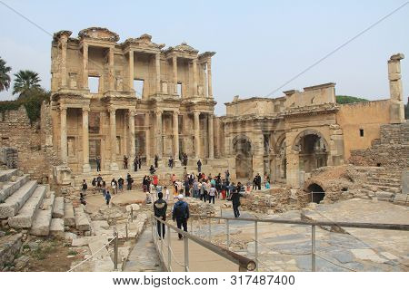 Ephesus, Izmir, Turkey - October 19, 2018:  Tourists By The Archaeological Ruins Of The Celsius Libr