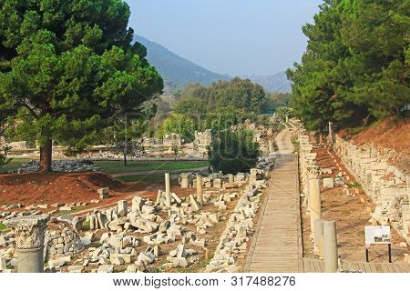 Scenic View Of Mountains And Marble Columns Beside A Wooden Walkway Along The Commercial Agora In Th
