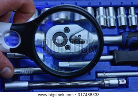 Black Magnifier In Hand Increases Toolbox In Blue Box