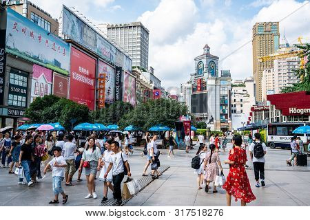 Chengdu Sichuan China, 3 August 2019 : View Of Chunxi Road With Clock Tower Building Full Of People