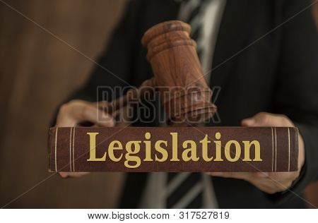 Legislation Concept. Lawyer Holding Legislation Books With A Judge Law.