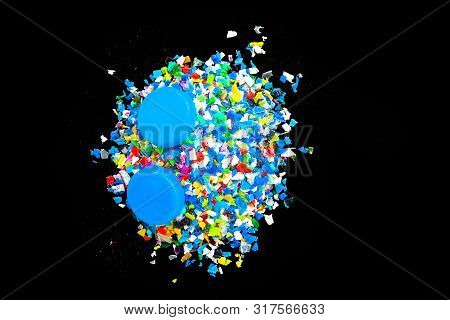 Crushed Plastic Granules For Recycling,  Crushed Plastic Granules Isolated On Black Background. Plas