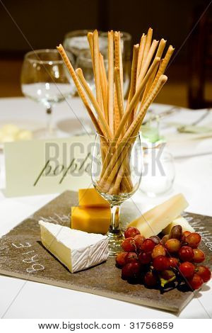 cheese and bread sticks set out during a catered event