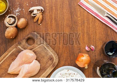 Raw Fillet. Cooking Chicken. Bread With Flour, Starch And Spices. Lemon, Fresh Champignons, Onions,