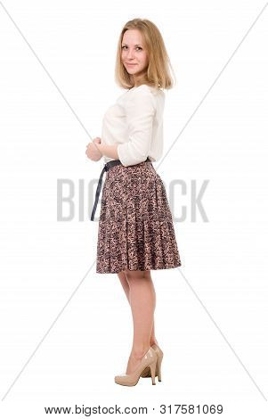 Fashion Portrait Of A Young Blonde In A Skirt Posing In Full Growth Isolated Over A White