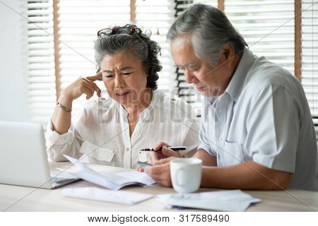 Serious Asian Senior Couple Thinking About Their Debts With Laptop Computer. Saving, Financials, Mon