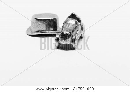 Umea, Sweden - June 30, 2019: Game Pieces From Monopoly, Car And Hat On White Background With Studio