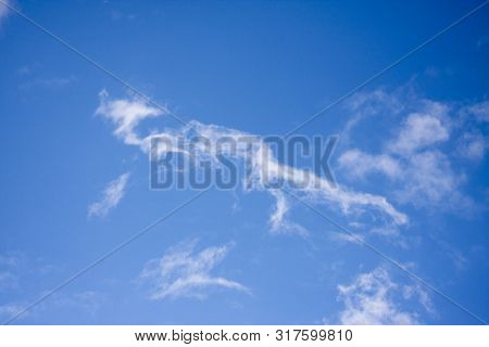 White Clouds On Blue Sky Background. Ozone Layer. The International Day For The Conservation Of The