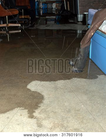 The Cement Floor Of The Basement Will Soon Be Underwater From Heavy Missouri Rains. Items Stored Are