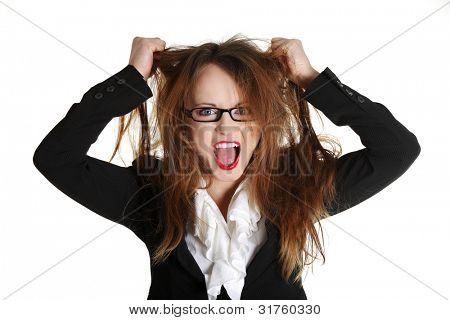 Stressed business woman is going crazy pulling her hair in frustration.