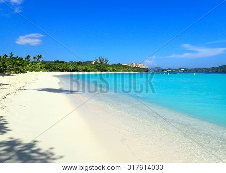 Beautiful Lindquist Beach Day On St. Thomas Us Virgin Islands With Clear Blue Skies, Palm Trees And