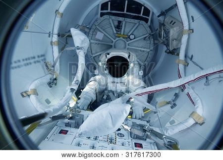 Astronaut At The Control Panel In A Space Shuttle. Elements Of This Image Were Furnished By Nasa For