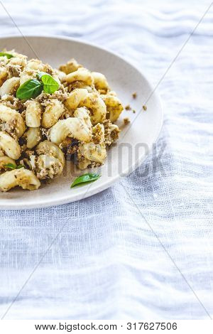 Traditional Soviet Russian Pasta Dish, Vermicelli, Navy Pasta, With Meat On A White Plate On A Light