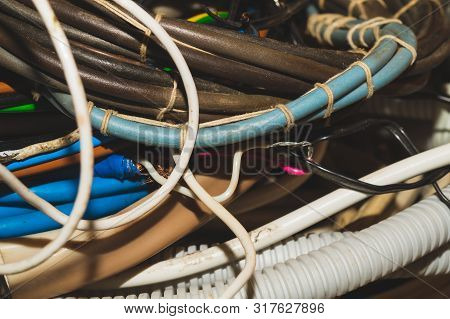 Used electric colorful wires. hank of different old cables close up poster