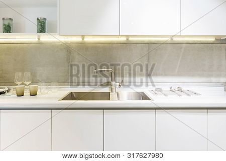 poster of Stainless kitchen sink and Tap water in the kitchen. The interior of the kitchen room of the apartment. Built-In Appliances. Kitchen Appliance. Domestic Appliances