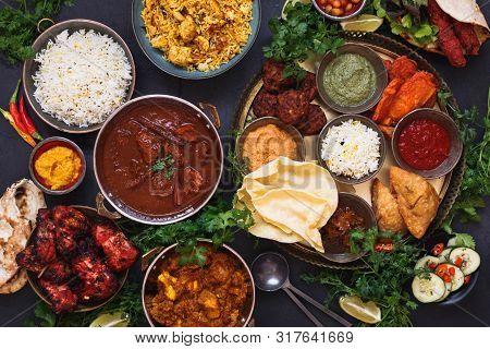 Various Indian Dishes Featuring  Rogan Josh, Chicken Tikka Masala, Biryani, Tandoori Chicken, Kebabs
