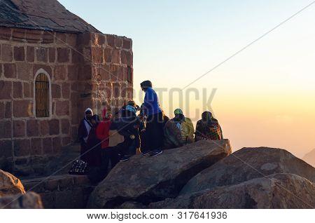 Sinai Peninsula, Egypt, May 9, 2019: Pilgrims Meet The Dawn On The Moses Mountain, Sinai Peninsula,