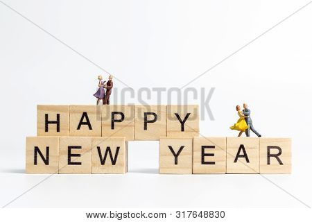 Couple Danding On Wooden Block  Happy New Year Concept