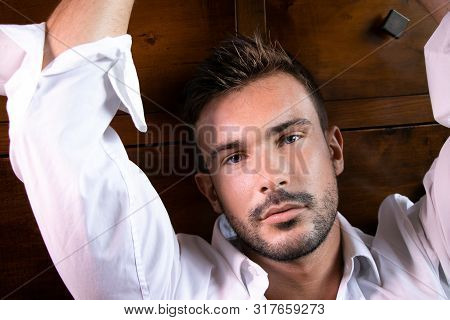 Handsome Bearded Man With Open Shirt Revealing Hairy Chest Looking At Camera