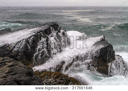Large Waves Crashing Onto Coastal Rocks At Mistaken Point, Newfoundland