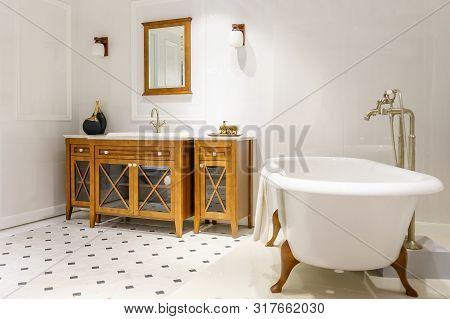 Modern Loft Bathroom Interior Design With White Tile Walls, White Bathtub And White Basin On Wooden