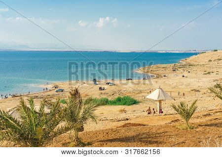 Dead Sea, Jordan - October 13, 2018: People Floating On Water In The Dead Sea Jordan .the Dead Sea I