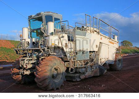 Soil Stabiliser Machine On A Road Construction Site