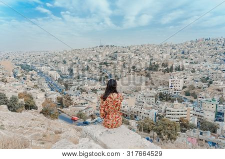 Young Woman Enjoying The View Of The City From Amman Citadel Or Jabal Al-qal'aa, A Historic Site Fro