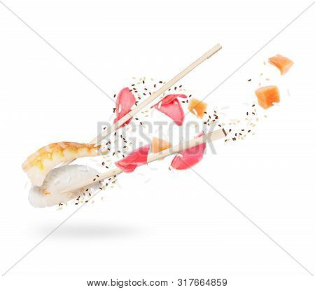 Unfolded Sushi Roll With Chopsticks Closeup On White Background