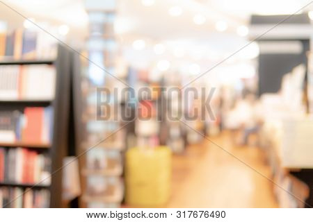 Abstract Blur Curved Bookshelf In Bookstore Or School Library. Blurred Bookshop Interior For Backgro