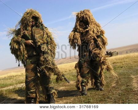 Camouflaged Soldier Aiming. Sniper. Army
