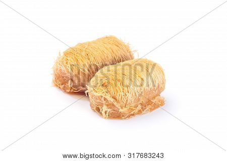 Two Greek Pastry Kataifi With Shredded Filo Dough Stuffed With Almond Nuts, In Honey Syrup, Isolated