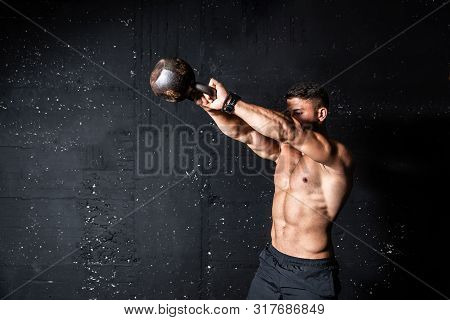 Kettlebell Swing Training Workout, Young Strong Sweaty Focused Fit Muscular Man With Big Muscles Hol