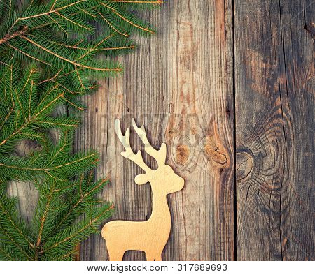 Green Branches Of Spruce, Wooden Toy Deer On An Old Gray Wooden Background, Holiday Backdrop, Copy S